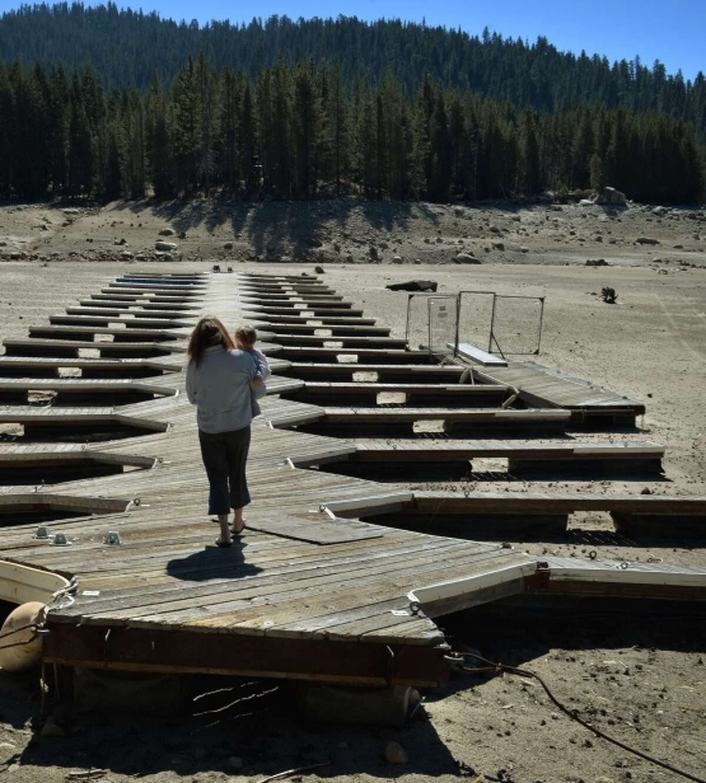 Mitzi Richards and granddaughter on the dock at Huntington Lake (Fresno County), at 30 percent of capacity.