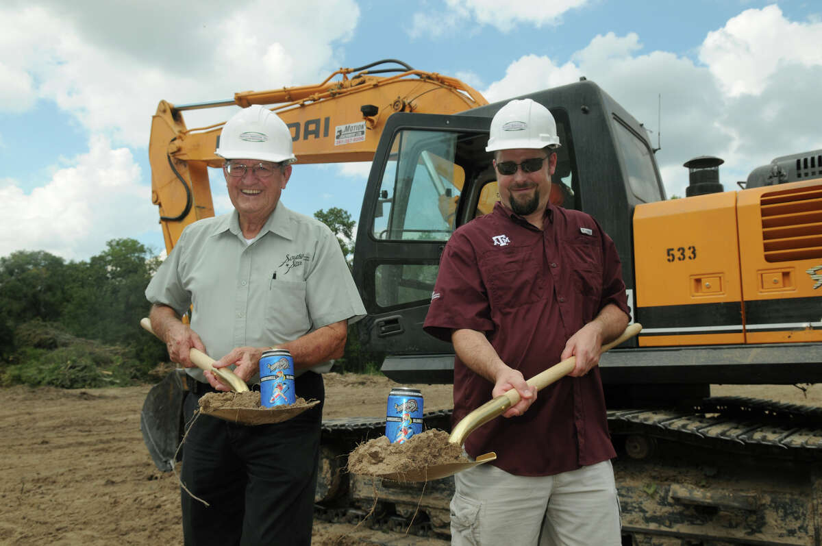 Chuck Fougeron, left, Vice-President of Southern Star Brewing Company, and his son, Dave, President, pose for photos during the groundbreaking ceremony for their brewing facility in Conroe.
