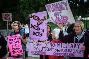 CodePink anti-war activists gather at the White House in Washington on Thursday to protest US-led military intervention in Syria and Iraq against the Islamic State group and call on President Barack Obama to return his Nobel Peace Prize. Activists remembered those affected by war and called for nonviolent solutions to the conflicts in Syria and Iraq. AFP PHOTO/Nicholas KAMMNICHOLAS KAMM/AFP/Getty Images