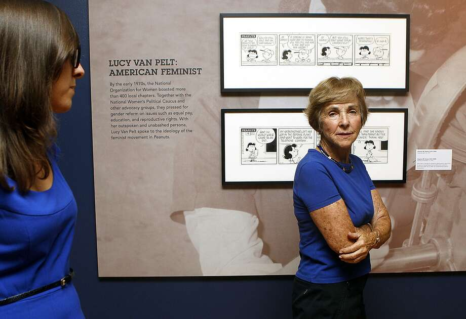 Curator Corry Kanzenberg (left) talks with Jean Schulz (right), wife of cartoonist Charles Schulz, as they show the Social Commentary exhibition at Charles M. Schulz museum in Santa Rosa, Calif., on Monday, September 22, 2014. Photo: Liz Hafalia, The Chronicle