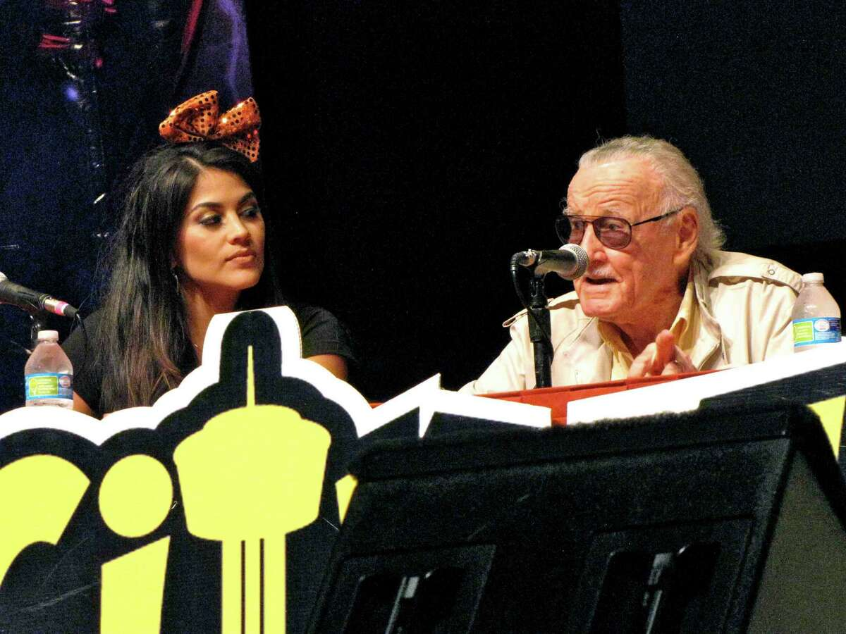 Comic book icon Stan Lee, headlining the second Alamo City Comic-Con, speaks to a packed house Saturday, Sept. 27, at Lila Cockrell Theater. At left is local TV personality Alanna Sarabia, who introduced Lee.