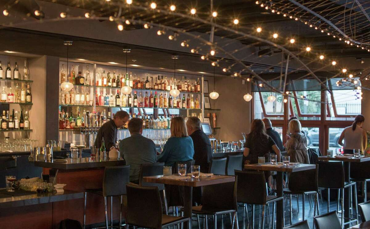 The bar at Plin in San Francisco features three large sculptural chandeliers that look like abstract fish skeletons.