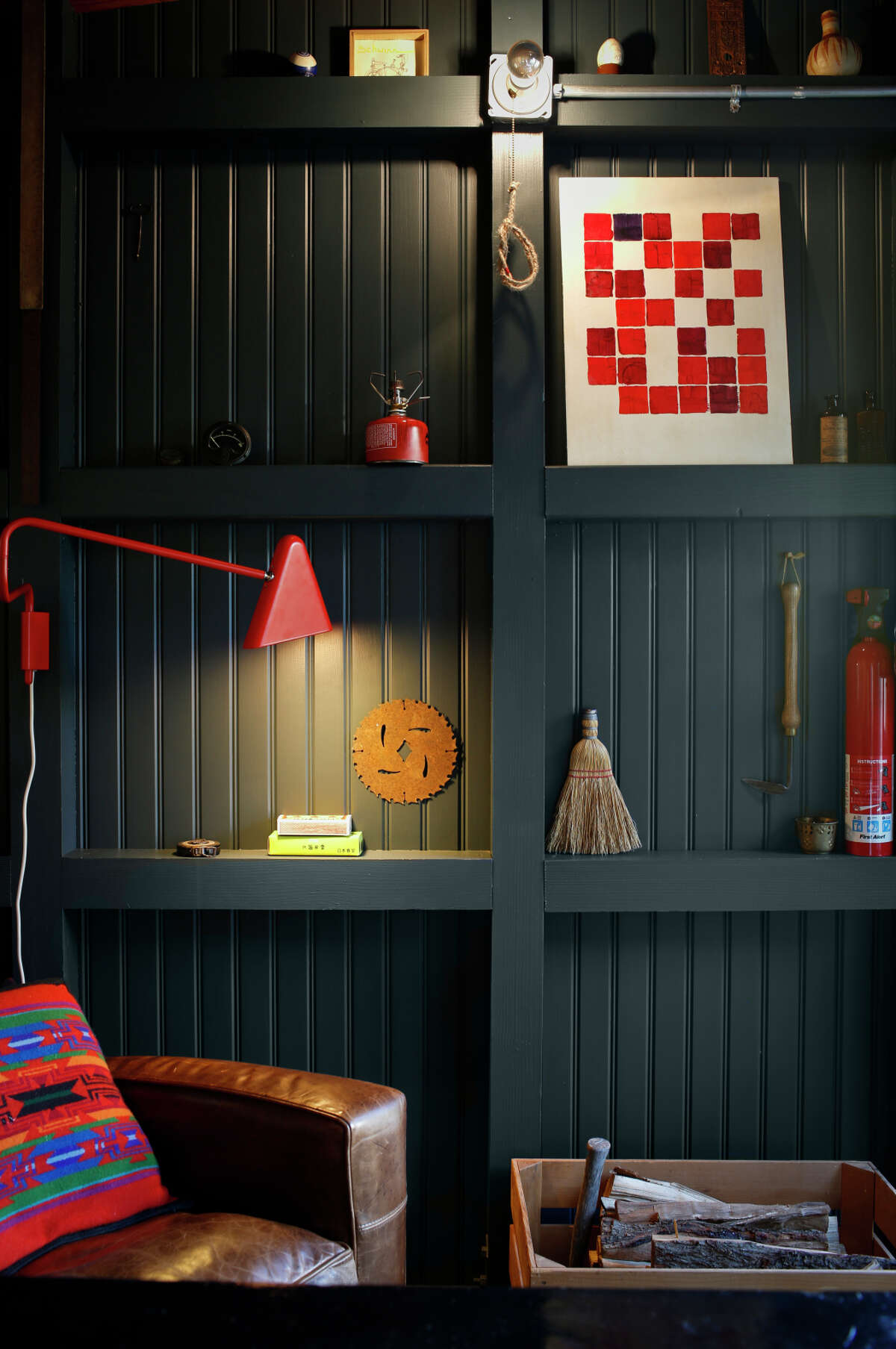 Lead Grey Benjamin Moore paint provides the shelving backdrop in blogger Caitlin Long's backyard office retreat.