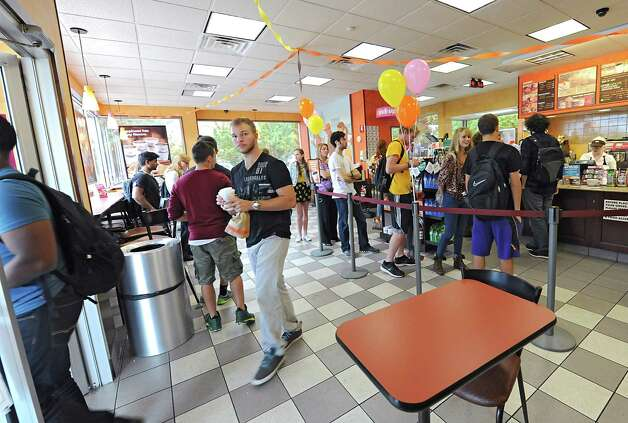 Customers, mostly UAlbany students, wait in line at Dunkin' Donuts on Washington Ave. near UAlbany on Monday Sept. 29, 2014 in Albany, N.Y. The chain was celebrating National Coffee Day where guests can walk into any participating DunkinO Donuts restaurant in the Capital Region and receive a free medium cup of DunkinO Donuts hot Dark Roast Coffee, with a limit of one per guest. (Lori Van Buren / Times Union) Photo: Lori Van Buren / 10028802A