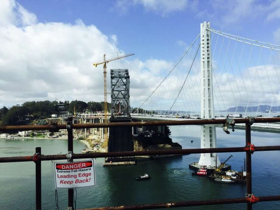 Over 170 engineers, consultants and other support staffers are still working on the Bay Bridge project.