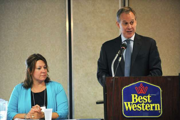 Attorney General Eric T. Schneiderman makes an announcement of $40 million in additional funding form homeowner protection program (HOPP) at the Best Western on Monday Sept. 29, 2014 in Clifton Park, N.Y. Faith Moore, CXHE board president sits at left. (Lori Van Buren / Times Union) Photo: Lori Van Buren / 10028803A