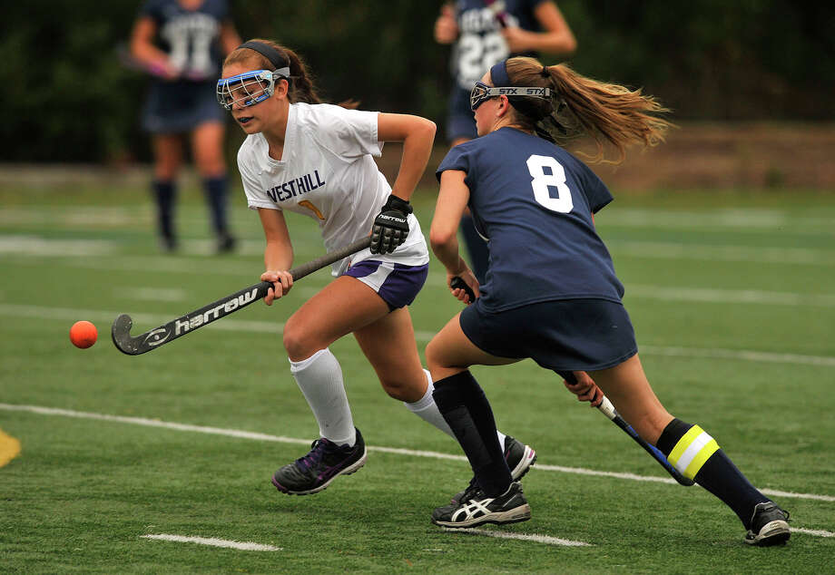 Westhill's Paige Sottosanti is pressured by Wilton's Kristen Godin during their field hockey game at Westhill High School in Stamford, Conn., on Monday, Sept. 29, 2014. Wilton won, 2-1. Photo: Jason Rearick / Stamford Advocate