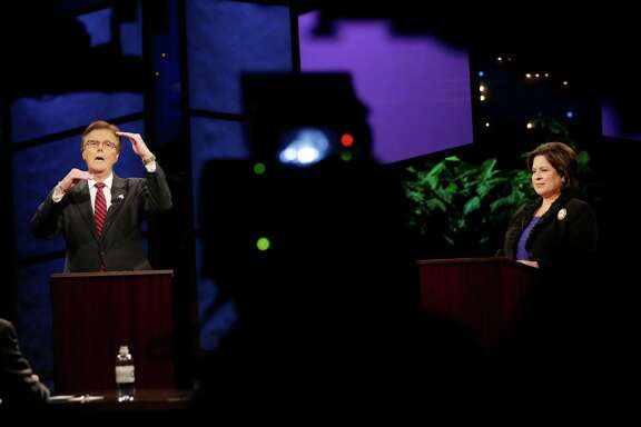 Texas Lieutenant Governor hopefuls state Sen. Dan Patrick, R-Houston, left, and state Sen. Leticia Van de Putte, D-San Antonio, right, take part in a televised debate, Monday, Sept. 29, 2014, in Austin, Texas. (AP Photo/Eric Gay, Pool)