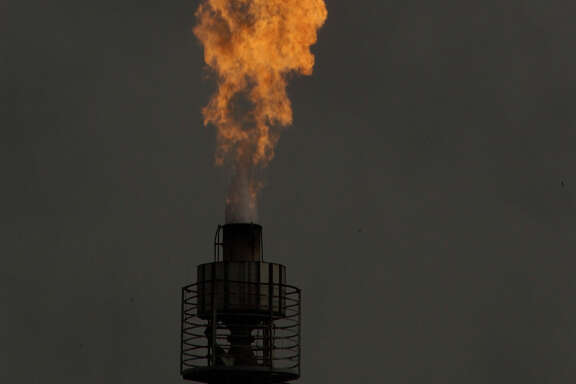 The Texas Commission on Environmental Quality has sites to monitor flares such as this one at Texas Petrochemical off Old Galveston Road in Houston.