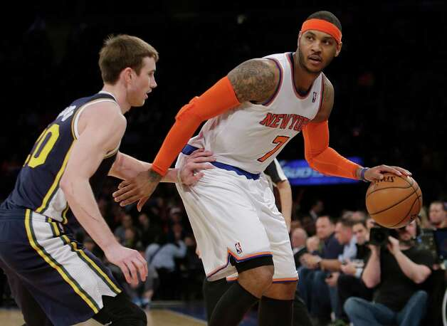 New York Knicks' Carmelo Anthony (7) is defended by Utah Jazz's Gordon Hayward (20) during the second half of an NBA basketball game on Friday, March 7, 2014, in New York. The Knicks won the game 108-81. (AP Photo/Frank Franklin II) ORG XMIT: MSG113 Photo: Frank Franklin II / AP