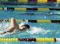 Darien junior Lauren Rutledge swims during an away meet at Wilton on Wednesday, Sept. 17.