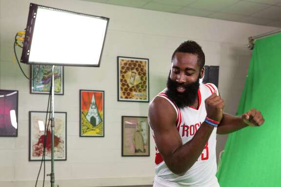 Rockets guard James Harden boogies to the music while making a video during media day at Toyota Center on Monday.