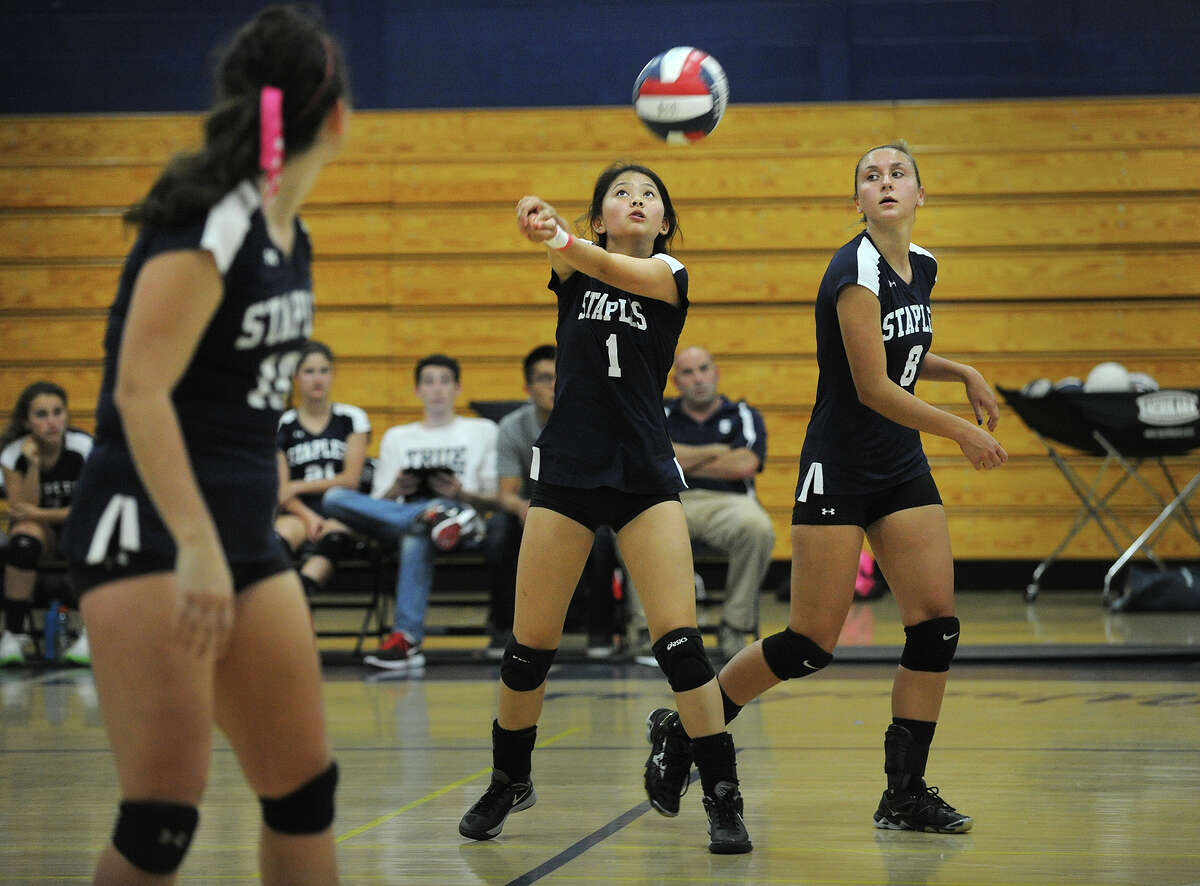 Staples' Hanna Ching passes the ball during their FCIAC girls volleyball match with Greenwich at Staples High School in Westport, Conn. on Monday, September 29, 2014.