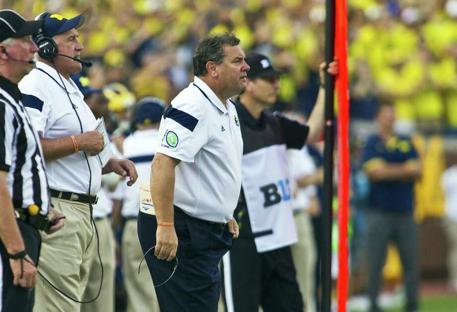 Michigan coach Brady Hoke has come under fire for allowing Shane Morris to return during Saturday's loss to Minnesota after the quarterback suffered an apparent head injury. Photo: Tony Ding / Associated Press / FR143848 AP
