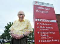 Heinrich Medicus, 95, poses for a photograph near the Samaritan Hospital sign on Thursday, Aug. 21, 2014, in Troy, N.Y.  (Paul Buckowski / Times Union)