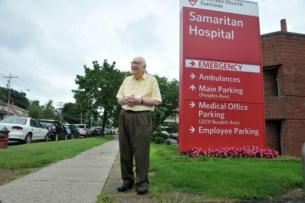 Heinrich Medicus, 95, poses for a photograph near the Samaritan Hospital sign on Thursday, Aug. 21, 2014, in Troy, N.Y.  (Paul Buckowski / Times Union) Photo: Paul Buckowski / 00028279A