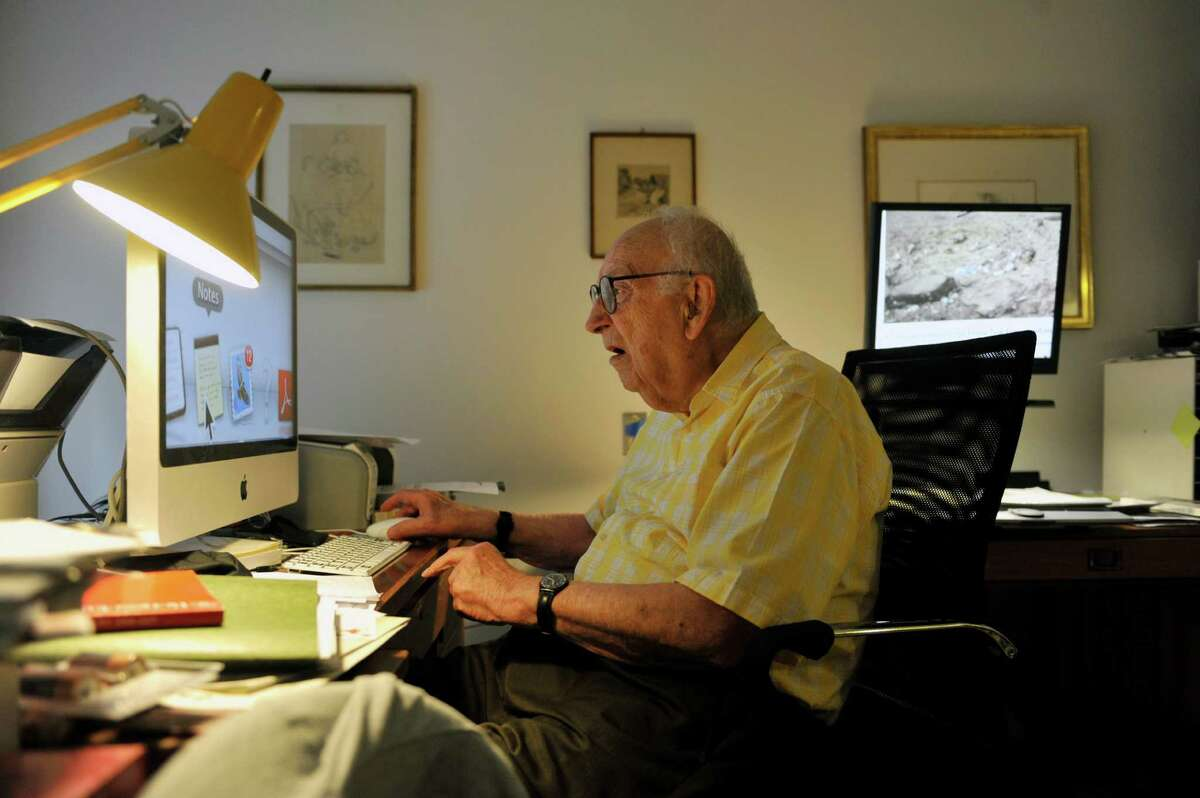 Heinrich Medicus, 95, works in his office in his apartment on Thursday, Aug. 21, 2014, in Troy, N.Y. (Paul Buckowski / Times Union)