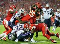 Kansas City Chiefs running back Jamaal Charles (25) dives into the end zone after catching a 5-yard pass for a touchdown during the second quarter of an NFL football game against the New England Patriots, Monday, Sept. 29, 2014, in Kansas City, Mo. (AP Photo/Ed Zurga) ORG XMIT: MOJR110