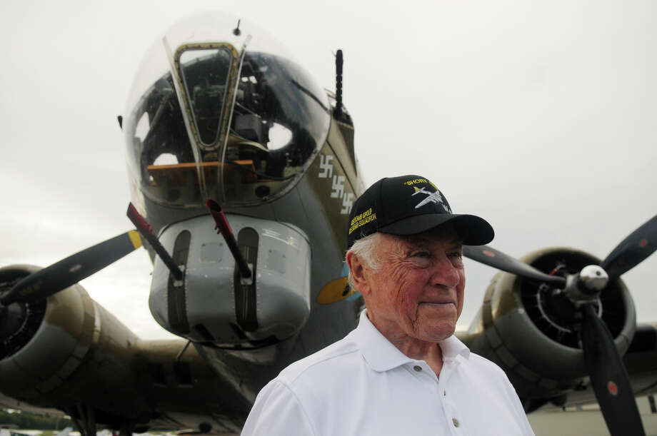 "Bob Wiley, 89, and a B-17 Flying Fortress Bomber plane at the Westchester County Airport in Armonk, NY, Sept. 29, 2014. Wiley was a nose gunner togglier in a B-17 called ""Strong Arm"" during World War II. The plane was used in the European theater during the war, with the 8th Air Force, 486 Bomb Group, 835 Bomb Squadrant. Photo: Keelin Daly / Greenwich Time Freelance"