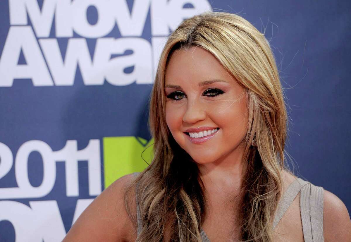 FILE - In this June 5, 2011 file photo, Amanda Bynes arrives at the MTV Movie Awards in Los Angeles. Bynes was arrested early on Sunday, Sept. 28, 2014, and booked on suspicion of driving while under the influence of a drug. She was released after posting $15,000 bail.