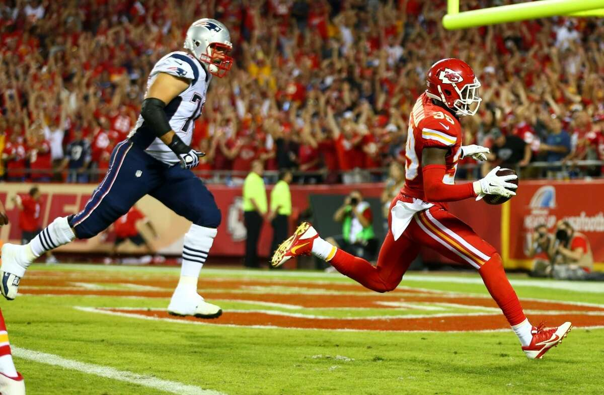 KANSAS CITY, MO - SEPTEMBER 29: Husain Abdullah #39 of the Kansas City Chiefs scores a touchdown after an interception against the New England Patriots at Arrowhead Stadium on September 29, 2014 in Kansas City, Missouri. (Photo by Dilip Vishwanat/Getty Images) *** BESTPIX ***