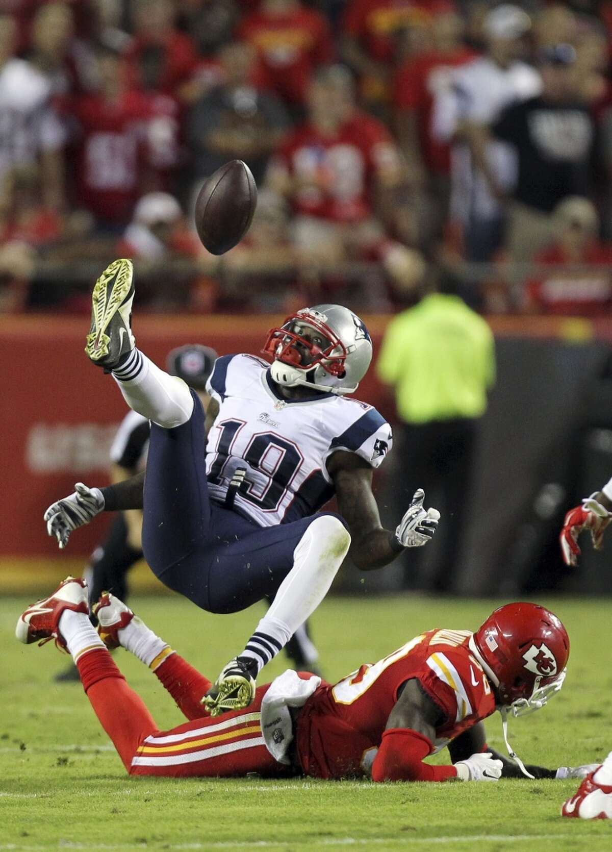 New England Patriots wide receiver Brandon LaFell (19) cannot come up with a pass as Kansas City Chiefs free safety Husain Abdullah, bottom, defends during the fourth quarter of an NFL football game Monday, Sept. 29, 2014, in Kansas City, Mo. (AP Photo/Ed Zurga)