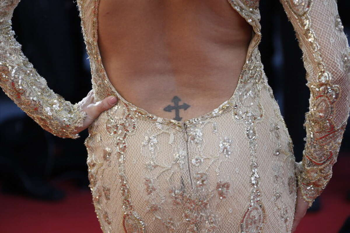 A photo shows US actress Eva Longoria's tattoo as she arrives on May 17, 2013 for the screening of the film