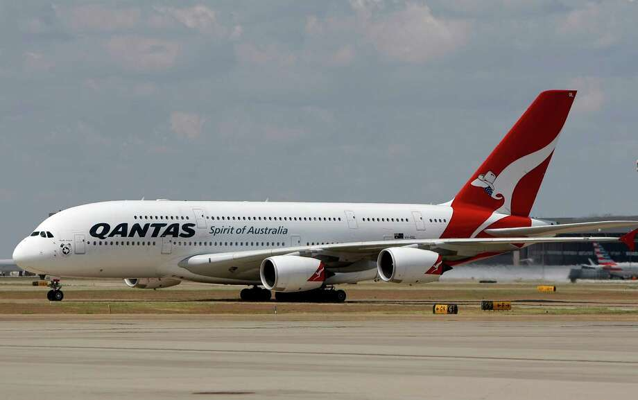 In this Sept. 29, 2014 photo released by Qantas, an Airbus A380 taxis to its gate during its inaugural landing at Dallas-Fort Worth International Airport in Texas, Monday, Sept. 29, 2014. Qantas is putting the world's biggest passenger plane on the world's longest airline route. The Airbus A380 touched down Monday at Dallas-Fort Worth International Airport, about 15 hours after leaving Sydney, Australia, on the 8,578-mile journey. (AP Photo/Qantas, Brandon Wade) Photo: Brandon Wade, HONS / Qantas