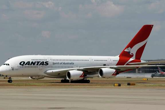 In this Sept. 29, 2014 photo released by Qantas, an Airbus A380 taxis to its gate during its inaugural landing at Dallas-Fort Worth International Airport in Texas, Monday, Sept. 29, 2014. Qantas is putting the world's biggest passenger plane on the world's longest airline route. The Airbus A380 touched down Monday at Dallas-Fort Worth International Airport, about 15 hours after leaving Sydney, Australia, on the 8,578-mile journey. (AP Photo/Qantas, Brandon Wade)