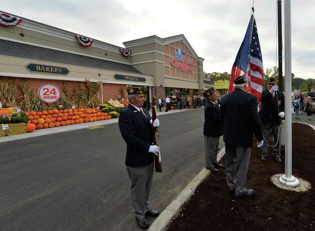 Members of the VFW Post 8692 raise the flag to the sounds of the Star Spangled Banner during the grand reopening of the Price Chopper Tuesday, Sept. 30, 2014, at Kimberly Square in Loudonville, N.Y.     (Skip Dickstein/Times Union) Photo: SKIP DICKSTEIN / 10028792A