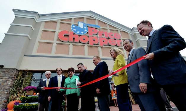 With axe in hand co-manager Michael Antini makes the grand reopening of the Price Chopper official Tuesday Sept. 30, 2014, at Kimberly Square in Loudonville, N.Y.     (Skip Dickstein/Times Union) Photo: SKIP DICKSTEIN / 10028792A