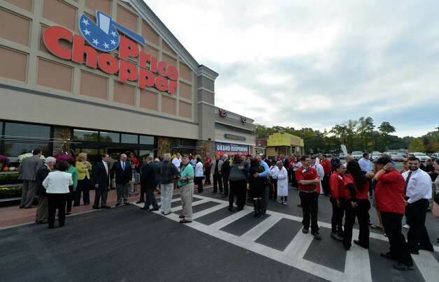 Employees and well wishers mingle after the ribbon cutting during the grand reopening of the Price Chopper Tuesday Sept. 30, 2014, at Kimberly Square in Loudonville, N.Y.     (Skip Dickstein/Times Union) Photo: SKIP DICKSTEIN / 10028792A