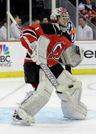 New Jersey Devils goaltender Johan Hedberg, of Sweden, makes a save during the first period of an NHL hockey game against the Philadelphia Flyers, Wednesday, March 13, 2013, in Newark, N.J. (AP Photo/Bill Kostroun) Photo: Bill Kostroun / FR51951 AP