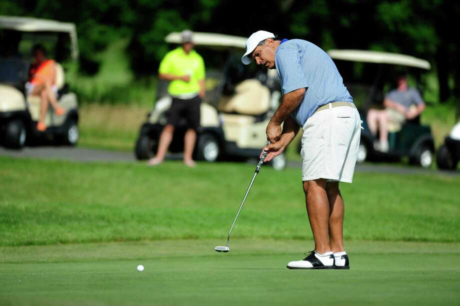 Dan Russo putts on the 17th green during the final round of the Troy Invitational at the Country Club of Troy on Sunday, June 22, 2014, in Troy, N.Y.  (Paul Buckowski / Times Union) Photo: Paul Buckowski / 00027010A