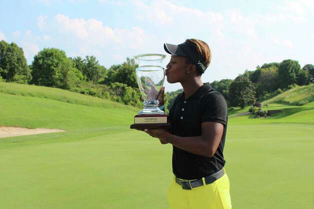 Sadena Parks kisses the trophy after winning the Symetra Tour's SEFCU Championship at Capital Hills Golf Course on Sunday, July 27, 2014. (Courtesty of Symetra Tour)