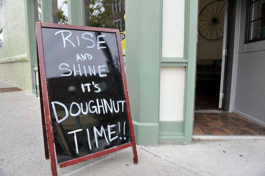 A sign outside the store front at Nibble Inc., a donut shop at the corner of Fifth Ave and Broadway, in Troy, N.Y. on Tuesday, Sept. 30, 2014.  The shop held a soft-opening on Saturday and has been open for business since Monday morning.   The shop uses local ingredients to make the 500 to 600 donuts they will produce for each day.  The shop will sell simple donuts, signature donuts and cocktail donuts, which are custom made to order donuts with fillings and toppings.  (Paul Buckowski / Times Union) Photo: Paul Buckowski / 10028818A