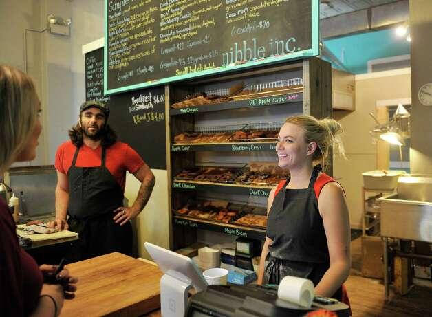 Business partners Michael Cunningham and Jessie Cramer talk with a customer at their business, Nibble Inc., a donut shop at the corner of Fifth Ave and Broadway, in Troy, N.Y. on Tuesday, Sept. 30, 2014.   (Paul Buckowski / Times Union) Photo: Paul Buckowski / 10028818A