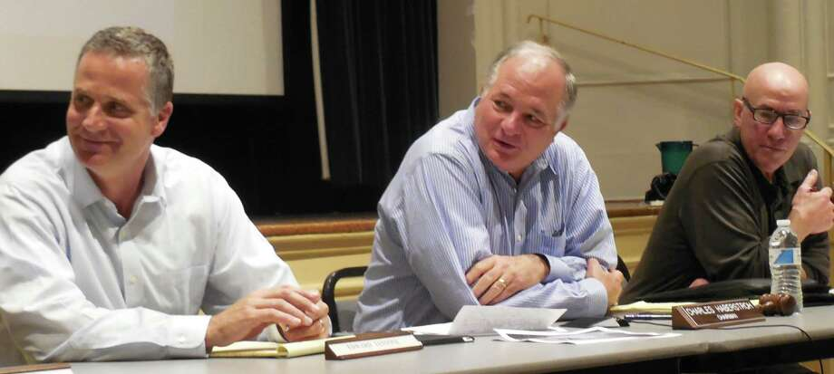 Park and Recreation Commission members, from left, Edward Iannone; Charles Haberstroh, chairman; and Steve Axthelm react to a comment during Monday's meeting on the Compo Beach master plan. Photo: Anne M. Amato / westport news