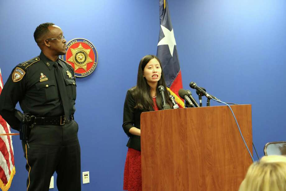 Assistant Chief Marlin Suell of the Harris County Sheriff's Office, left, and Julie Waters of Free the Captives discuss a new report on sex trafficking ads in Houston, Sept. 30, 2014. Photo: Harris County Sheriff's Office