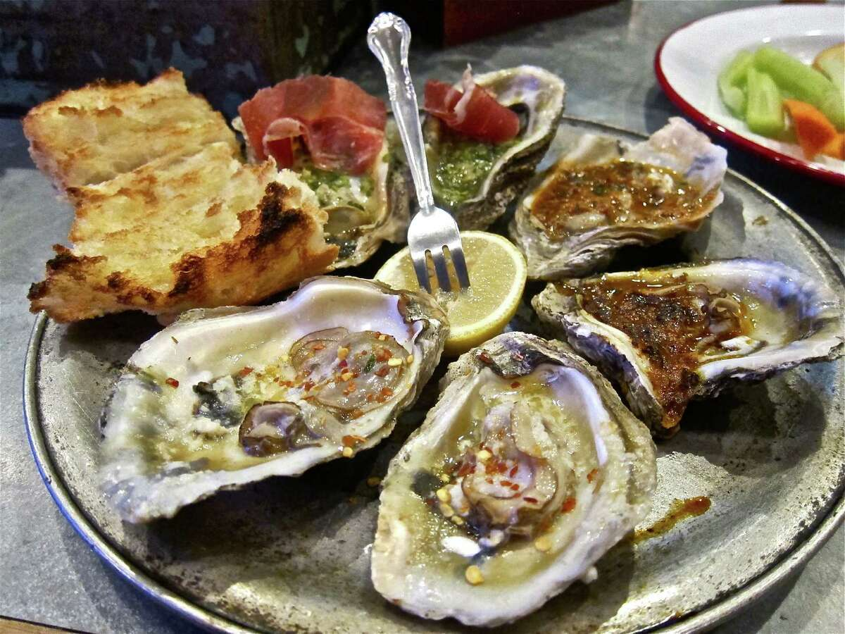 Assorted broiled oysters at Punk's.