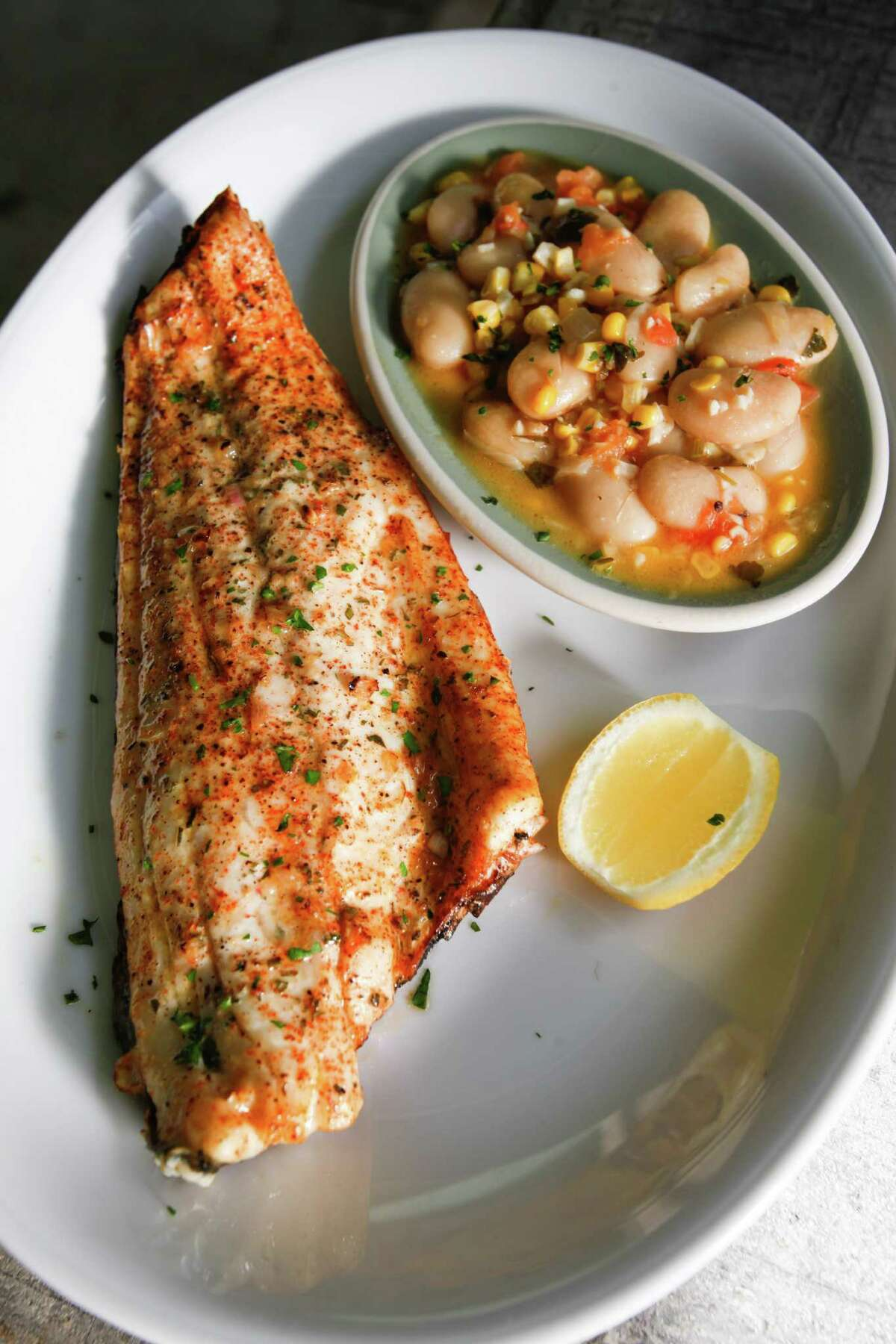 Redfish on the half shell with butter bean succotash at Punk's Simple Southern Food.