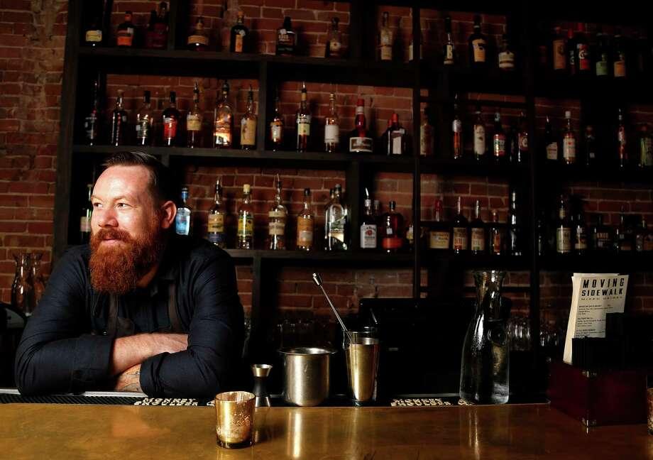 Moving Sidewalk bar owner/bartender Alex Gregg at the bar of his new bar, which is the old Goro & Gun space at 306 Main, Wednesday, Sept. 24, 2014, in Houston. ( Karen Warren / Houston Chronicle  ) Photo: Karen Warren, Staff / © 2014 Houston Chronicle