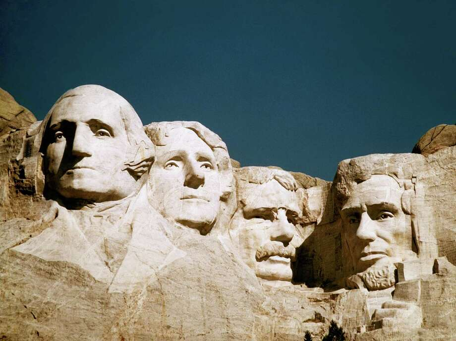 The statues of George Washington, Thomas Jefferson, Teddy Roosevelt and Abraham Lincoln at Mount Rushmore in South Dakota. Photo: STF / AP