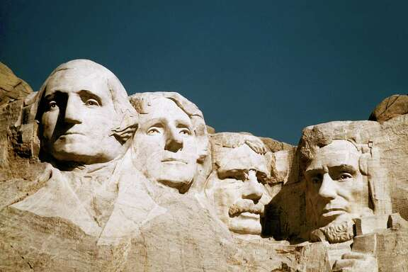 The statues of George Washington, Thomas Jefferson, Teddy Roosevelt and Abraham Lincoln at Mount Rushmore in South Dakota.