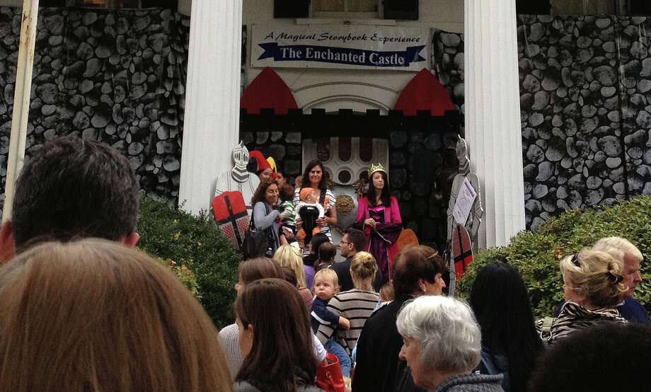 Crowd waits to enter the Enchanted Castle: A Magical Storybook Experience at the Burr Homestead, which returns to the Old Post Road mansion during the Halloween season. Photo: Contributed Photo / Fairfield Citizen