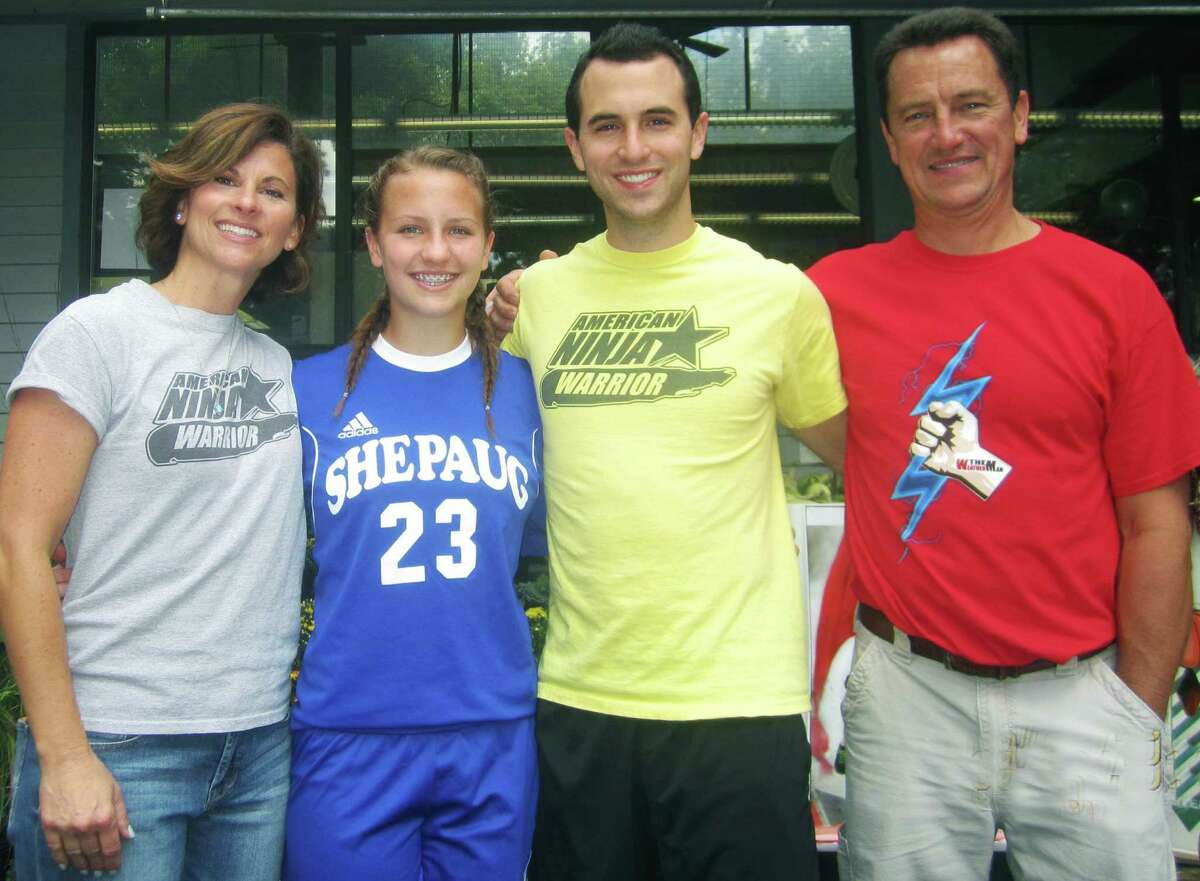 """""""American Ninja Warrior"""" standout Joe Moravsky takes a quick break during his busy """"Meet and Greet"""" at Sherman IGA to pose with his parents, Robin and Joe, and his younger sister, Samantha, an excellent athlete in her own right at Shepaug Valley School in Washington. Their sister, Ali, was absent due to her own commitment playing tennis for Western Connecticut State University. Sept. 20, 2014"""