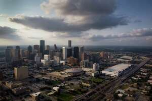 The downtown Houston skyline is seen in an aerial view with the Toyota Center, George R. Brown Convention Center, and Minute Maid Park seen at right,  on Friday, May 25, 2012, in Houston. ( Smiley N. Pool / Houston Chronicle )