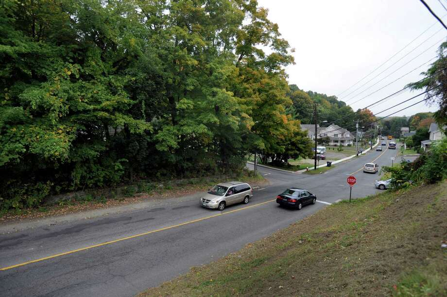 This photo shows a view of Maple Avenue in Bethel where it intersects at the stop sign with Hickok Avenue on the left. There is a proposed developement at the intersection of Hickok Avenue and Maple Avenue in Bethel, conn., that is set to include five large buildings and 70 units, which Zoning Board of Appeals chairman Justin Hurgin said will be detrimental to the surrounding homes in the neighborhood. Photo: Carol Kaliff / The News-Times