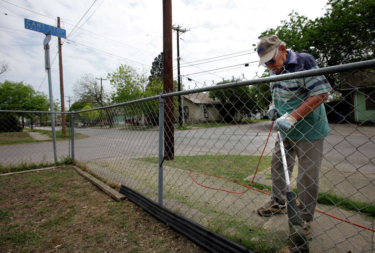 G.L. Rodriguez works on his yard near Can't Stop street in District 2 on the Eastside on Wednesday, Mar. 30, 2011. Rodriguez, 91, has seen his neighborhood become largely Hispanic which supports the latest census data. Kin Man Hui/kmhui@express-news.net