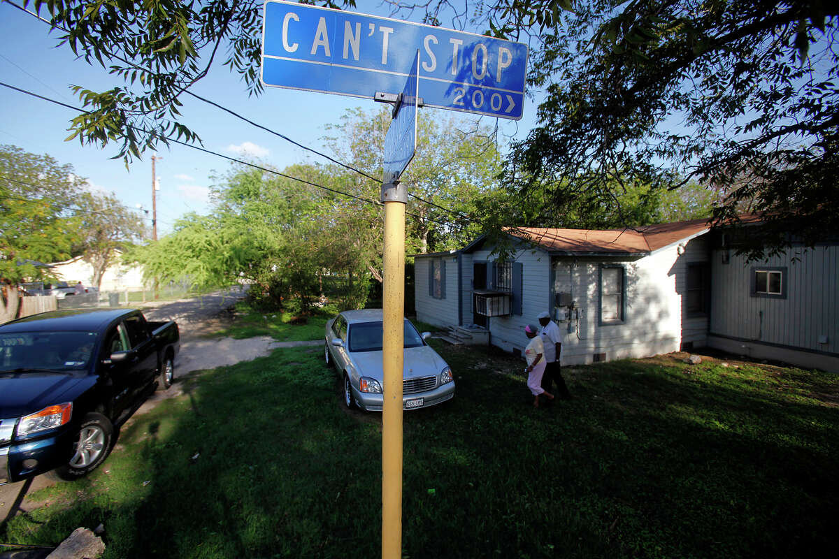 Margaret, 78, and Alonzo King, 83, walk across their lawn along Can't Stop St. and to their car, Wednesday, October 7, 2009.